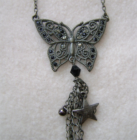 claires butterfly neckless detail
