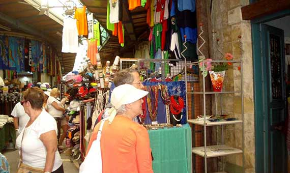 feature-bejay-main-picture-Tourists-browsing-in-Paphos-old-town-where-few-shops-sell-authentic-products
