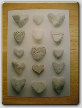 Greeting card with stone-carved hearts on it.