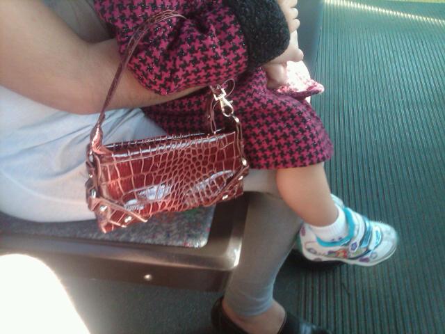 Little, little girl with a purse already