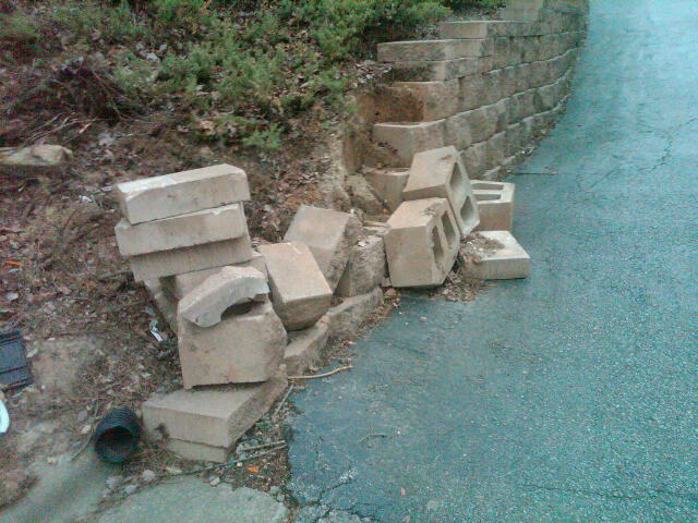 Fallen retaining wall in entrance to my townhouse area