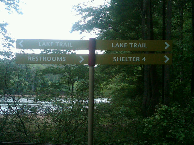 Signs indicating Lake Trail, Restrooms, and Shelter 4