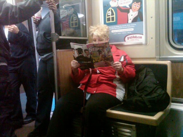 Helpful lady on the train reading some trashy Hollywood rag