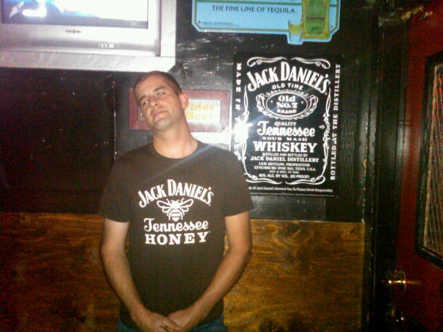 Matt's t-shirt with Jack Daniel's whiskey on it pretty closely matches an ad on the wall for JD whiskey