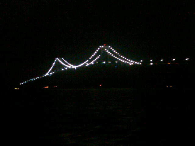 Bridge lights in the distance after passing under it