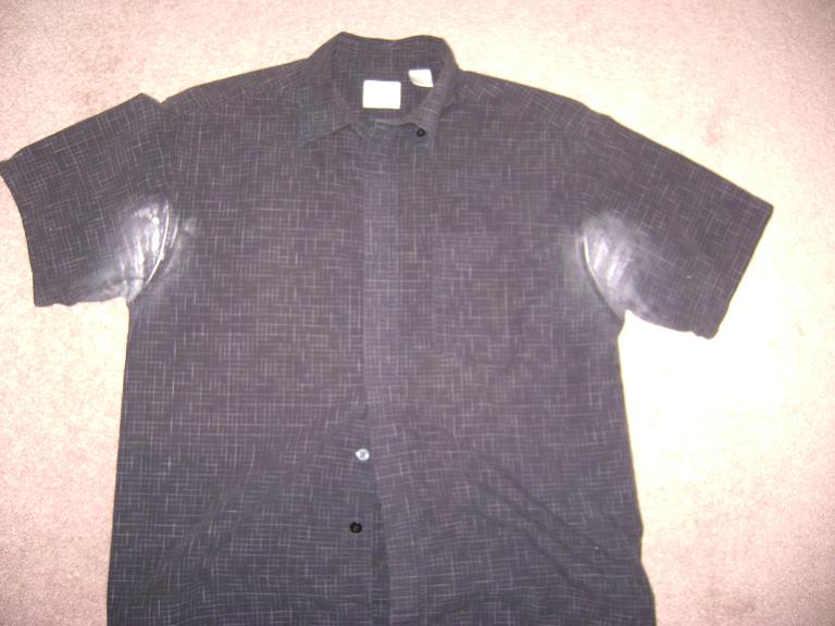 Short-sleeve black dress shirt with white stains under arms