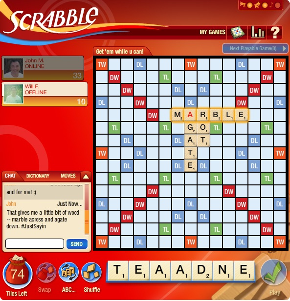 Scrabble board with marble going across and connected to it, going down, agate