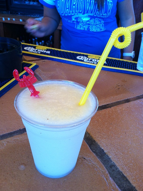 John's vodka-based banana-flavored margarita, complete with a lobster-handled stirer and a twisty-curl straw