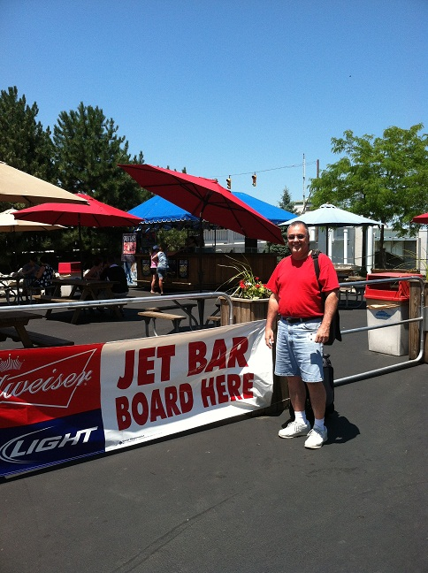 In front of the entrance to the Jet Bar with a gut hanging out