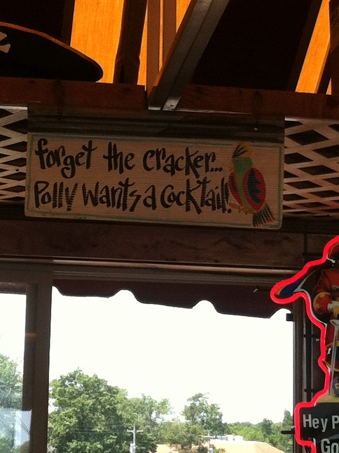 Sign over bar that said, 'Forget the cracker... Polly wants a cocktail!'