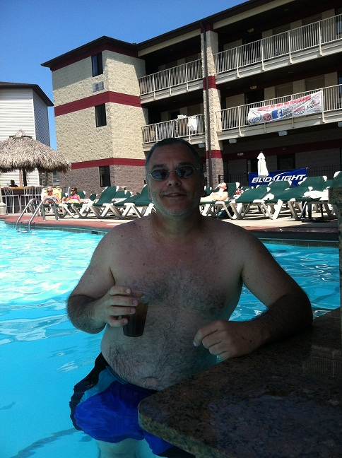 Me in the pool leaning against the in-water bar with a bourbon and diet in my hand.
