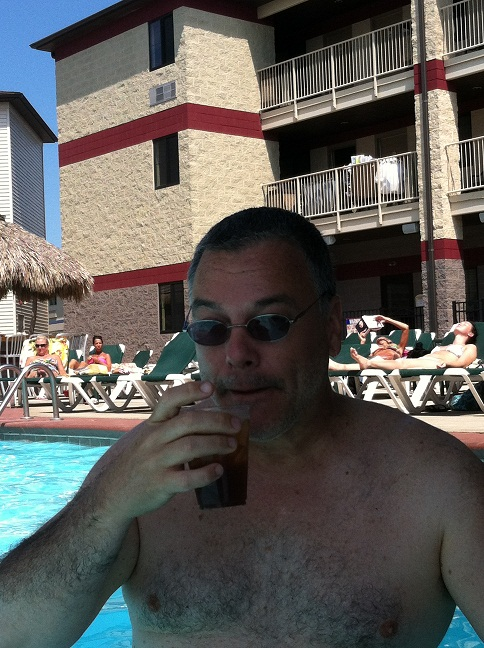 Me in the pool taking a sip of my bourbon and diet coke.
