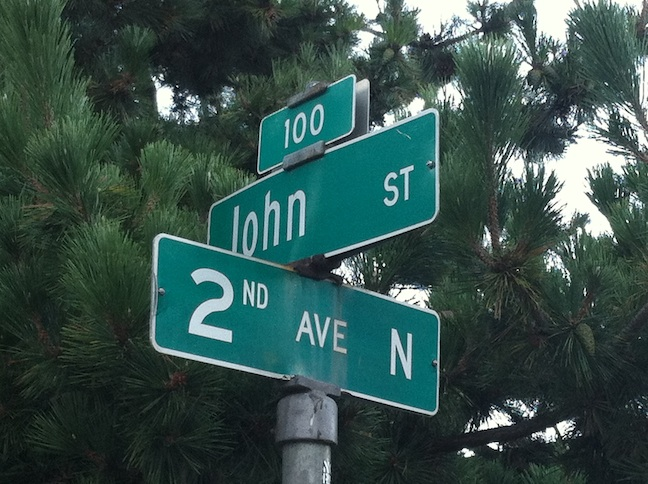 Street signs showing John St. intersecting with 2nd Ave N