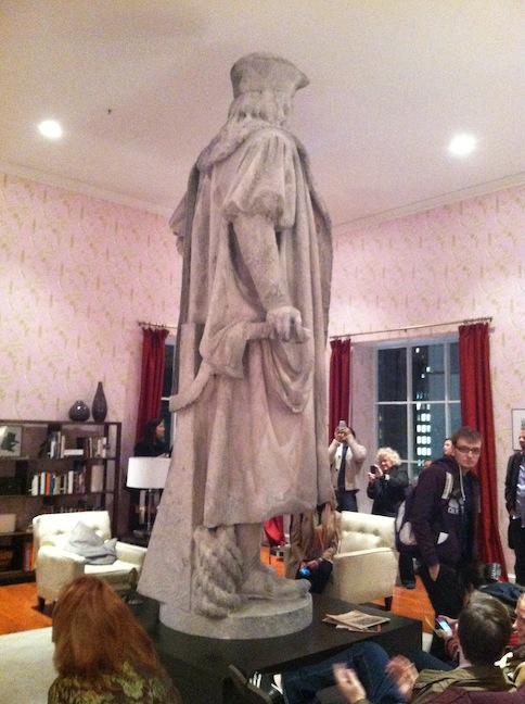 The top of the Christopher Columbus statue in the middle of a fully-furnished living room built around it
