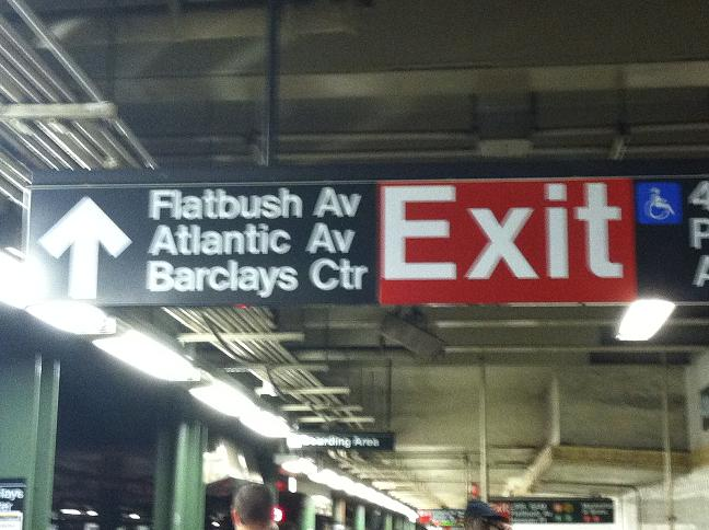Exit sign to Flatbush Ave, Atlantic Ave, and Barclays Center