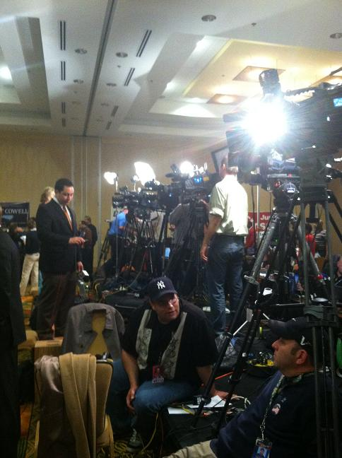 A bank of TV cameras and reporters