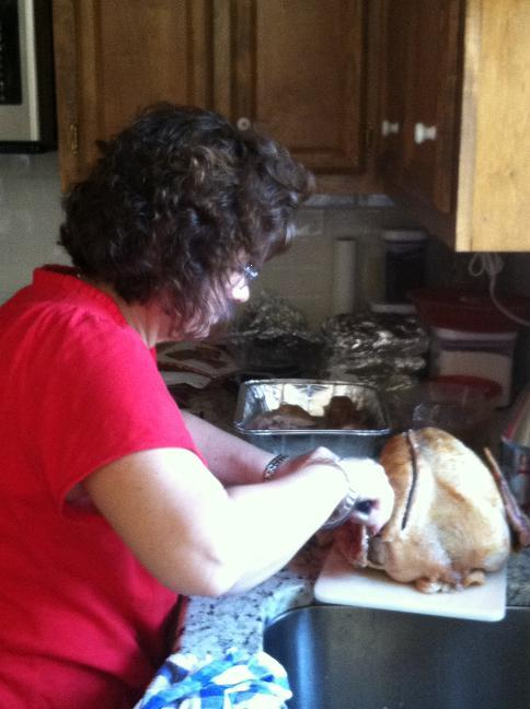 Vivian carving the turkey