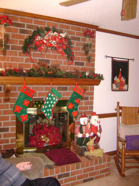 Their fireplace with stockings hung with care