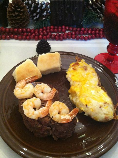 Filet mignon, shrimp, twice-baked potato and rolls