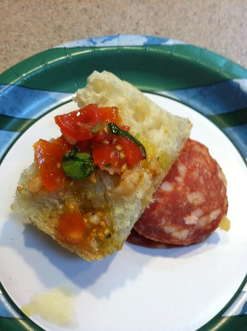 Bruschetta with a slice of salami on the side