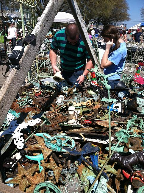 A FINE looking man looking through the heap of junk.