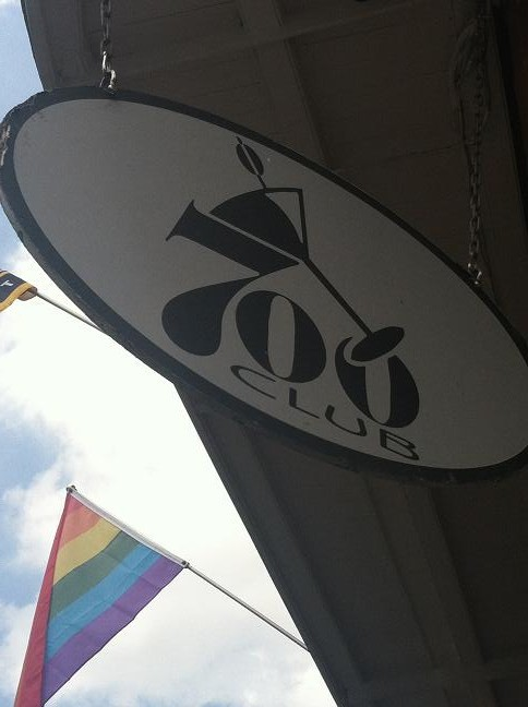 700 Club sign with gay flag waving in the background