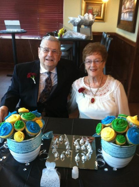 "Mom and dad seated at the table with ""floral cupcake"" centerpieces"