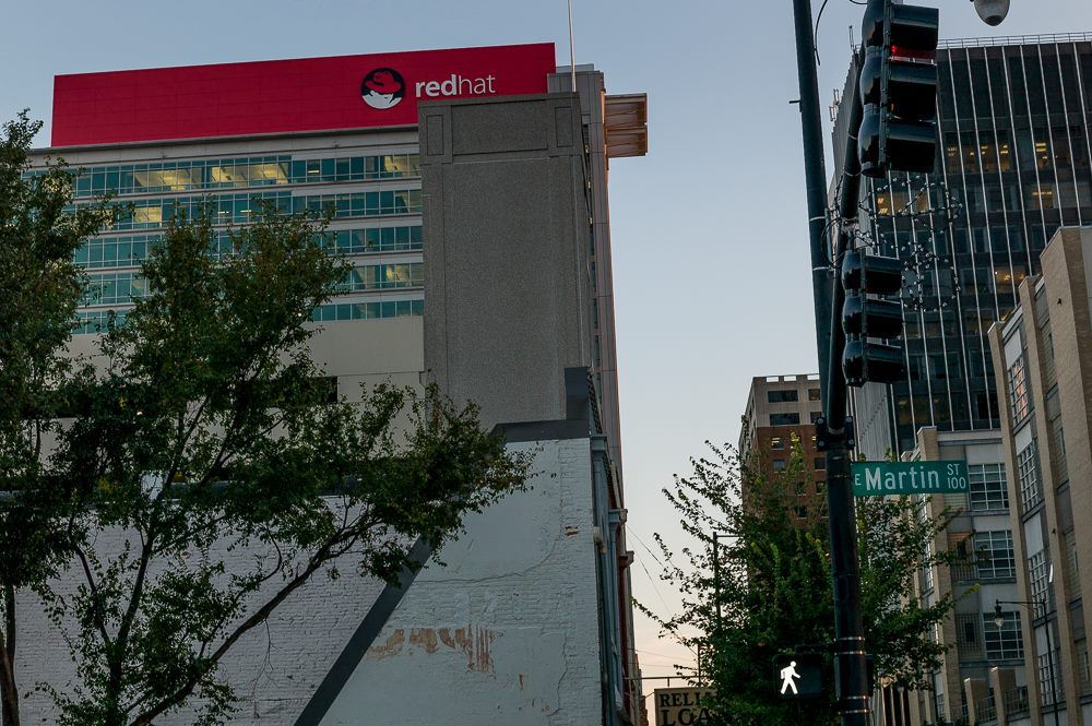 Red Hat building with Martin Street sign in front of it