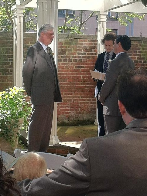 Terry and Michael listening to the officiant