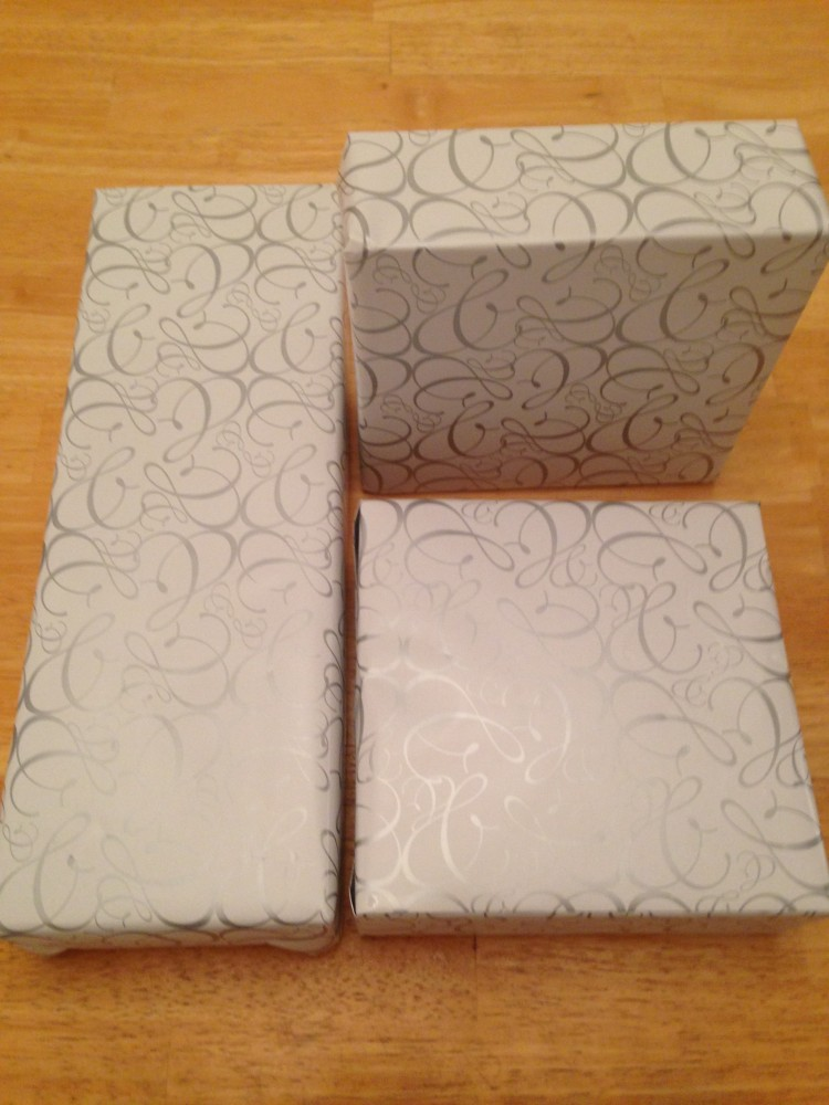 3 gifts wrapped in wedding paper