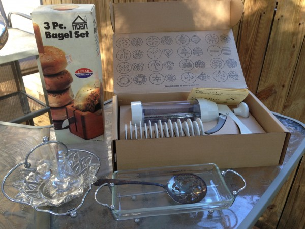 Cookie press, bagel set, a candy dish, and a cranberry dish set