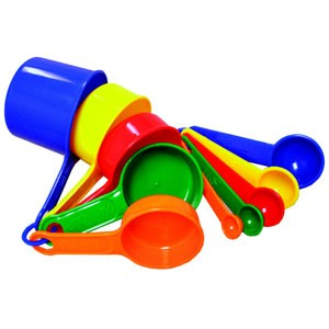 A set of multi-colored, plastic measuring cups and spoons.