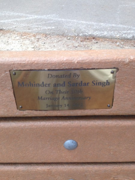 Plaque on bench saying: Donated by Mohinder and Sardar Singh on their 50th marriage anniversary January 14, 2012