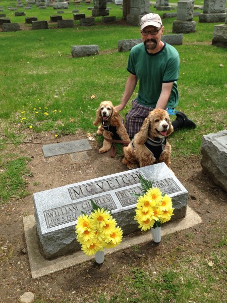 Bob, Frances, and Vincent by Bill and Ruth's grave, which has daisies on it