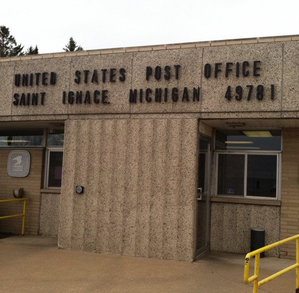 A postcard-mailing stop at the Saint Ignace Post Office