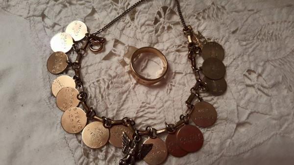 "Ruth""s wedding band and charm bracelet"