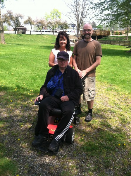 Billy, Mary, and Bob McVeigh in the park by Billy's house