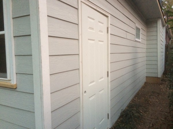 The new, expanded storage shed with siding