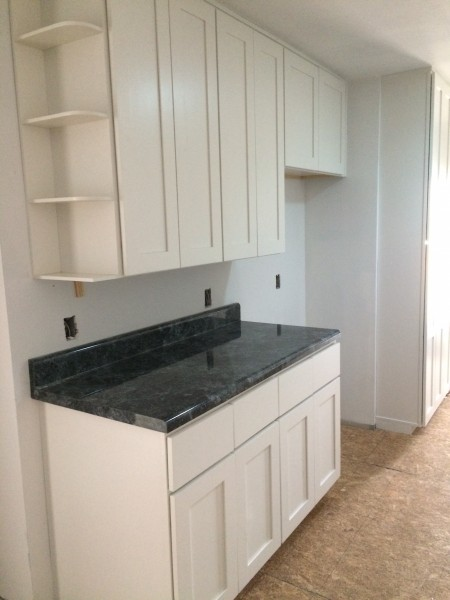 Counter tops on fridge side of galley kitchen