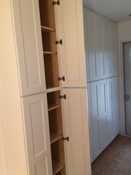Pantry cabinets with adjustable shelves