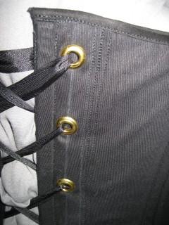 corset lacing, top binding