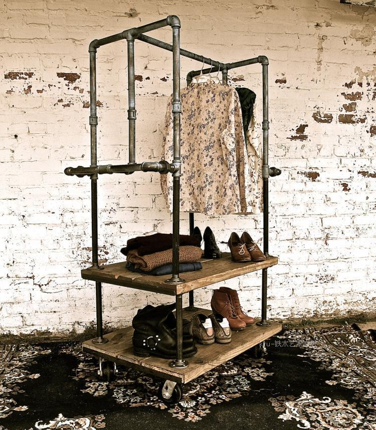 American-vintage-clothing-store-shelf-floor-hangers-coat-rack-made-of-old-iron-pipes-clothing-display.jpg