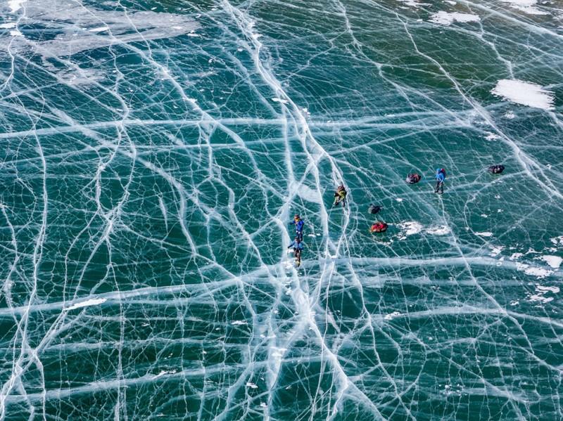 skaters-frozen-lake-baikal-russia_91084_990x742