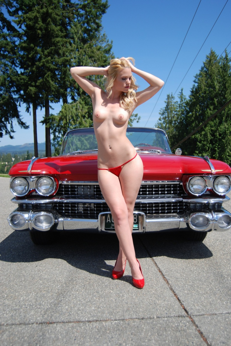 Beautiful Sexy Blonde Pin Up Style Girl Posing With Retro Car