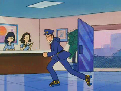 Said security guard rushing forward on his skates.