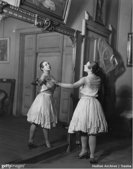 Ballerina Lydia Lopokova, Lady Keynes, exercises in front of a large mirror. (Photo by Sasha/Getty Images)