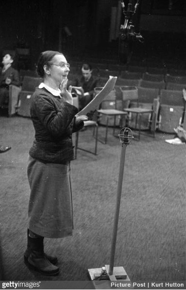 30th January 1943: Russian born ballerina and wife of the economist John Maynard Keynes, Lydia Lopokova reading from a script during a BBC radio recording of Tolstoy's 'War and Peace'. Original Publication: Picture Post - 1344 - The BBC Broadcasts The Worlds Greatest Novel: War & Peace - pub. 1943 (Photo by Kurt Hutton/Picture Post/Hulton Archive/Getty Images)
