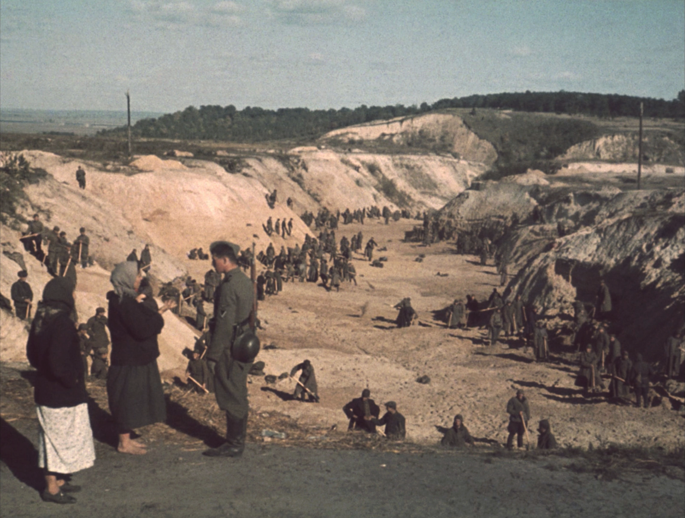 Soviet POWs covering a mass grave after the Babi Yar massacre, October 1, 1941.