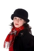 3150809-stylish-young-woman-in-red-plaid-scarf-and-black-hat-and-coat