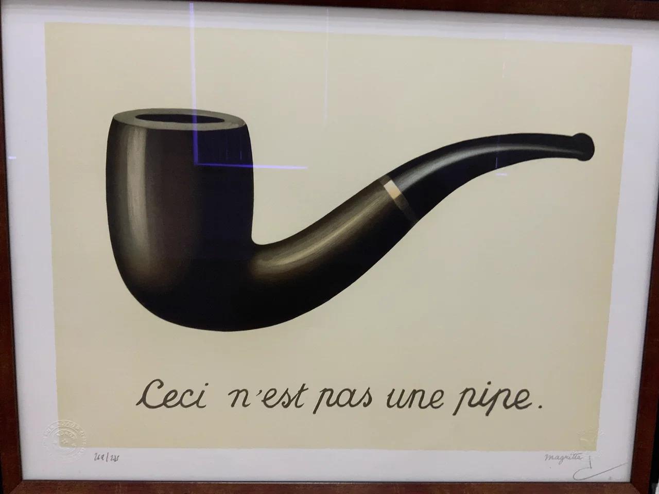 Рене Магритт «Вероломство образов (Это не трубка)» (1928-29)